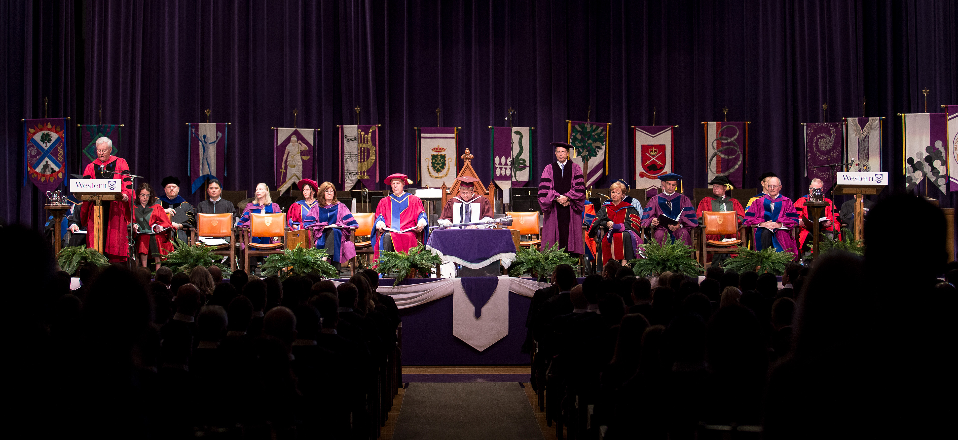Honourable faculty, alumni, and distinguished guests seated on stage at a convocation ceremony.