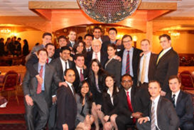 Dr. Athanassakos' Value Investing class poses with Mr. Buffett