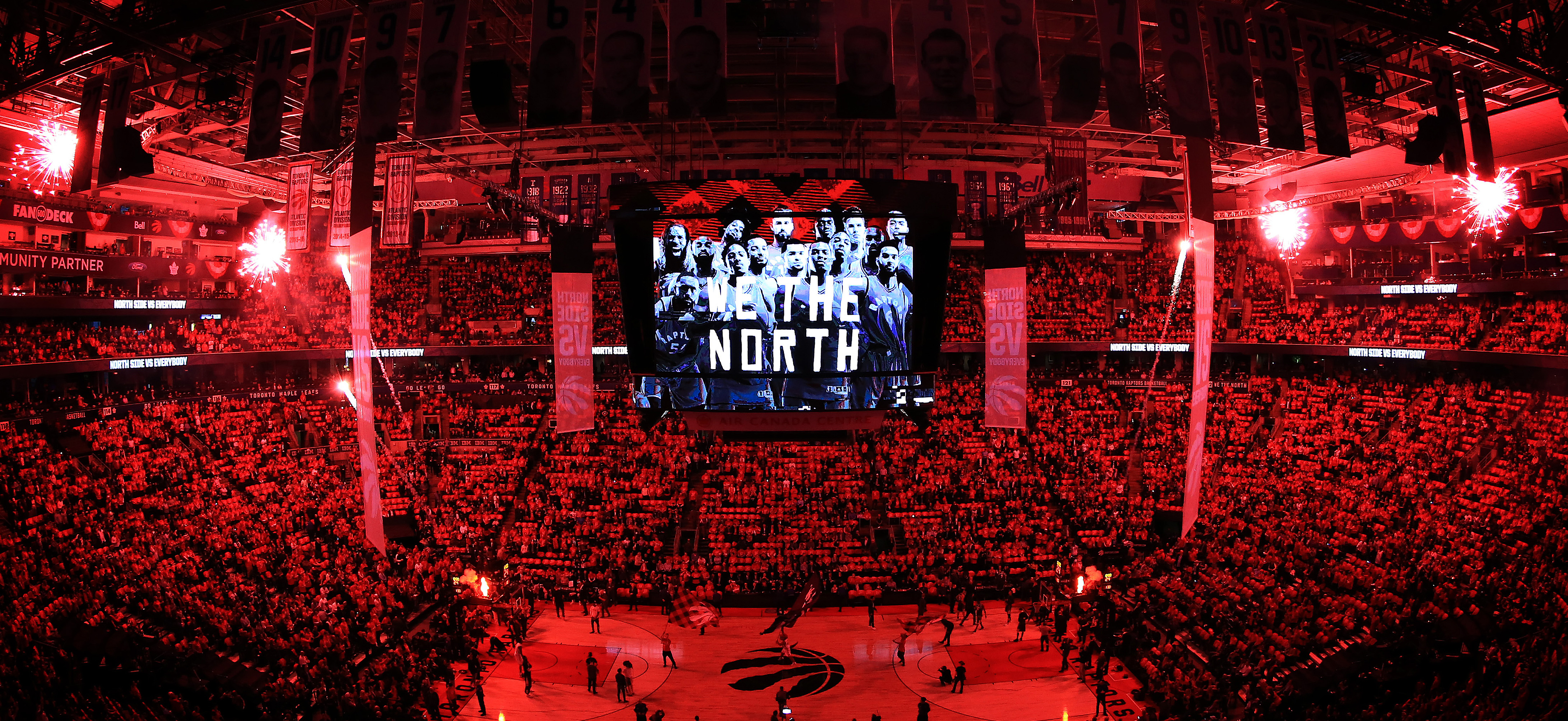 View of a Raptors' crowd at the Air Canada Centre featuring the We The North theme on-screen.