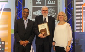Peter Bell receives distinguished service award